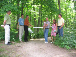Carey Carolinian Arboretum and Trail Ribbon Cutting: Left to right: Peter Snow President Lower Thames Valley Conservation Foundation, Mark Carey, Richard Carey, David Carey and baby Serena, Susan Carey, and John Carey.