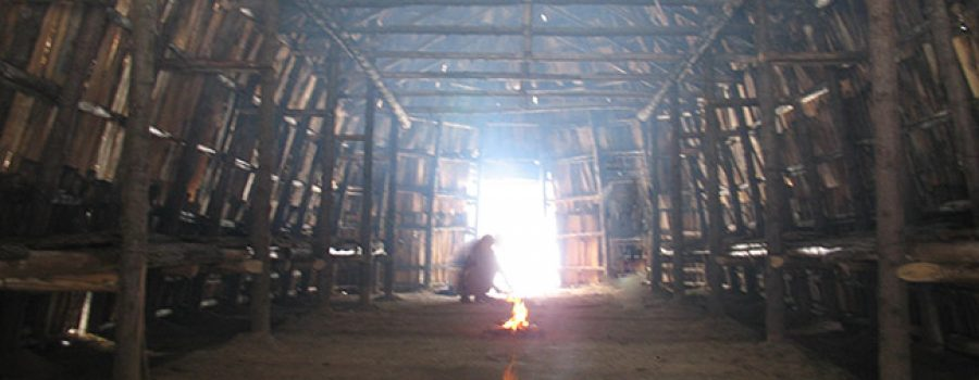 inside longhouse with firepit