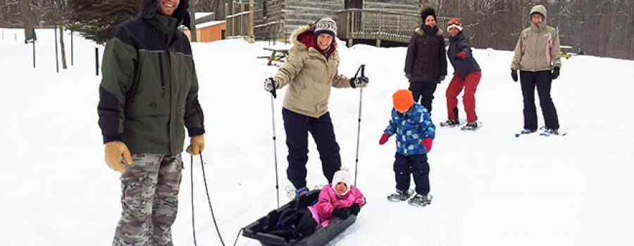 Families snowshoeing