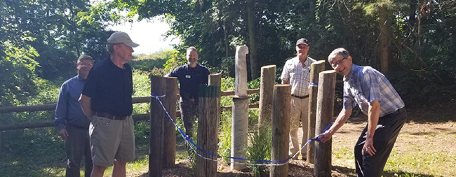 """group cutting ribbon at E.M. Warwick Conservation Area """"The Oluuc"""" sculpture unveiling August 13 2020"""